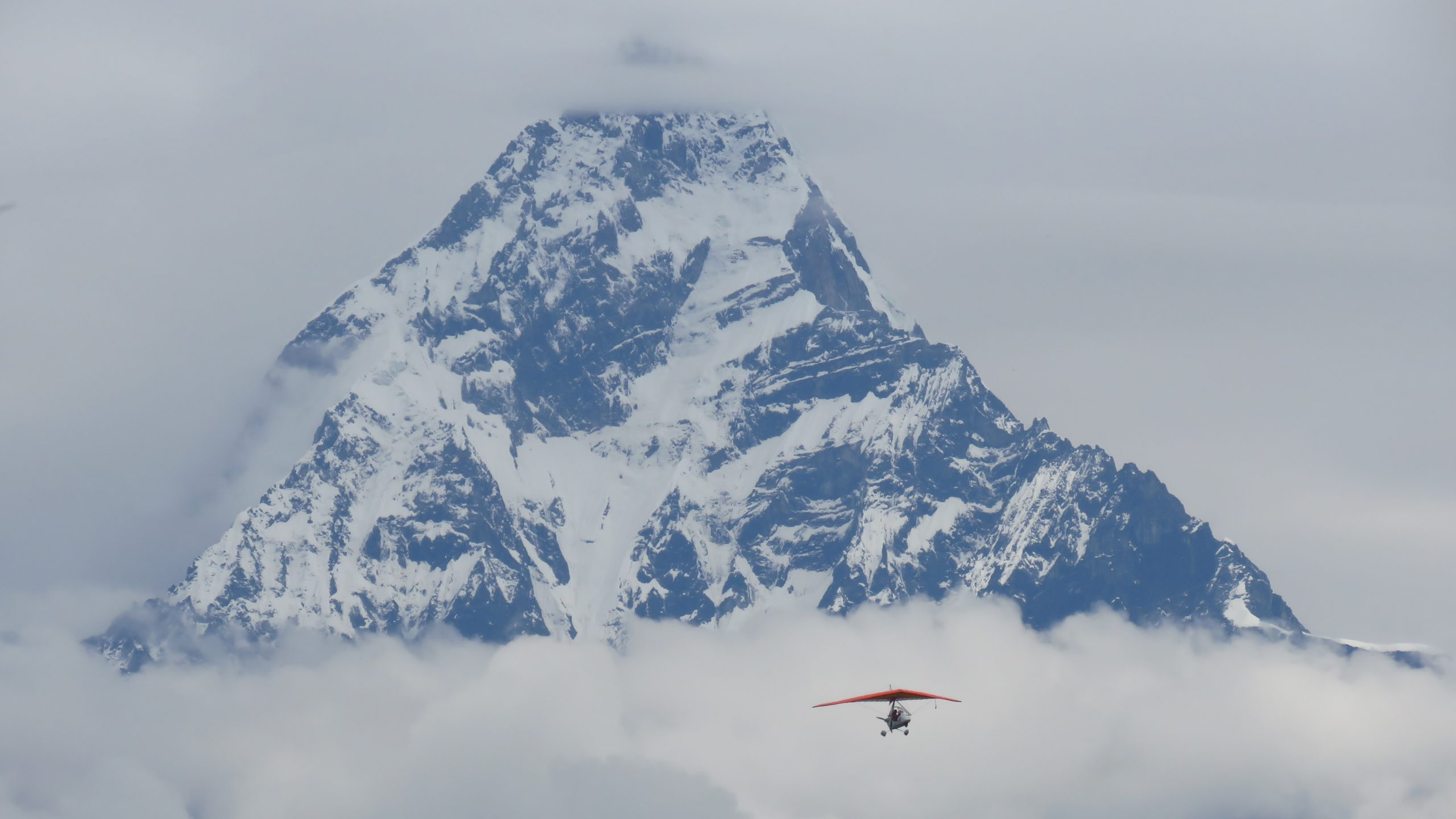 Ultralight aircraft in mountain sight seeing